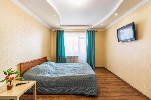 Кровать или кровати в номере липовская 16б 36