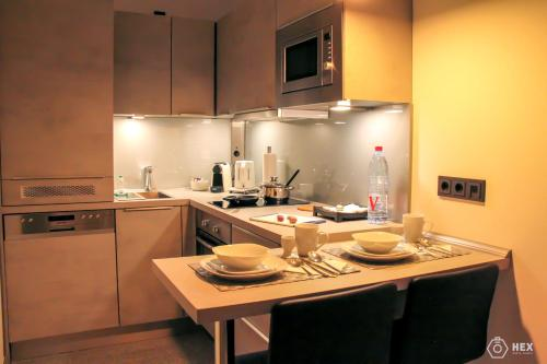 A kitchen or kitchenette at Bluestone Boarding Apartments