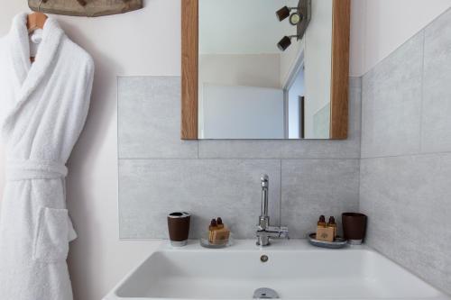 Ein Badezimmer in der Unterkunft Les Cottages d'Annie