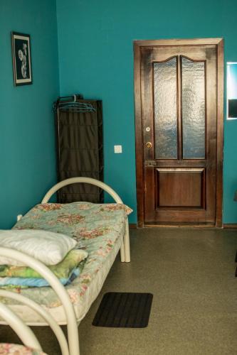 Кровать или кровати в номере Хостел Tranzit