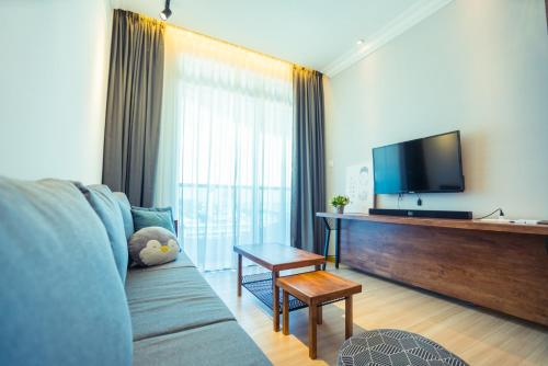 A television and/or entertainment center at Exclusuite The Wave Comfy Home @ Malacca