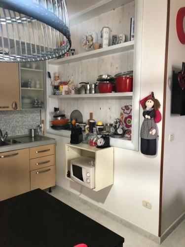 A kitchen or kitchenette at Appartamento al casale