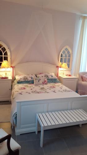 Un ou plusieurs lits dans un hébergement de l'établissement Moulin de Cot
