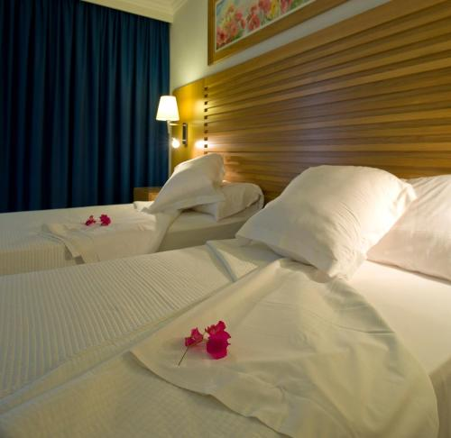 A bed or beds in a room at Bon Sol Prestige - AB Group