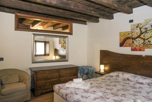 En eller flere senge i et værelse på Residence Villa Vinco