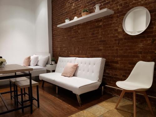 Zona de estar de Broadway Suite NY - Family Two Bedroom