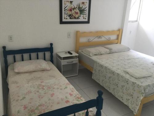 Postel nebo postele na pokoji v ubytování Residencial Vecchio