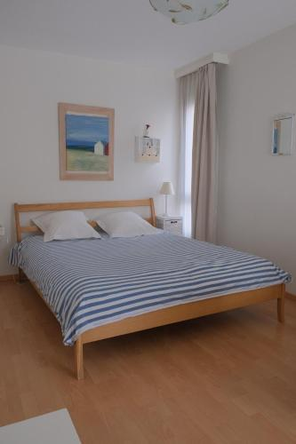 A bed or beds in a room at Chez Paula
