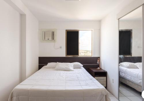 A bed or beds in a room at Super Apartamento Em Boa Viagem