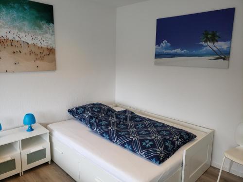 Ein Bett oder Betten in einem Zimmer der Unterkunft Ferienwohnung Central