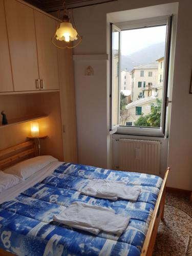 Łóżko lub łóżka w pokoju w obiekcie House Camogli