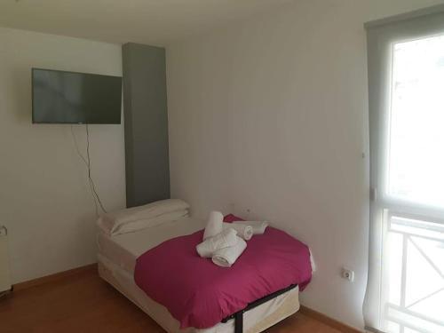 Cama o camas de una habitación en Apartamentos Zona Media