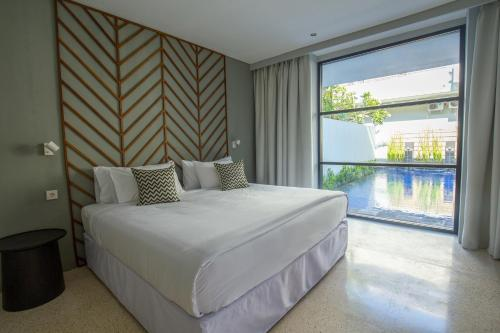 A bed or beds in a room at Origin Seminyak