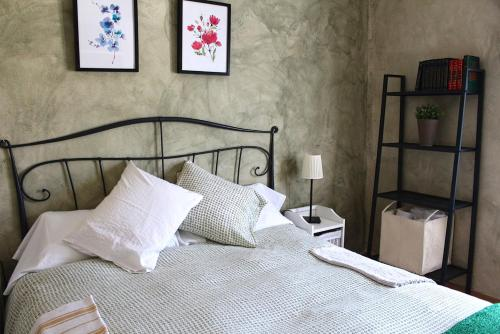 A bed or beds in a room at Casa del Plantel