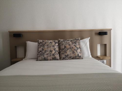 Un ou plusieurs lits dans un hébergement de l'établissement AMHotel Italie