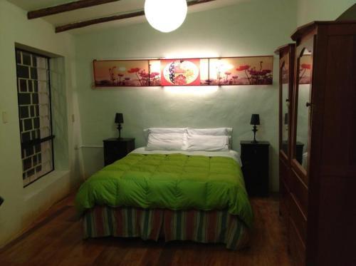 Cama o camas de una habitación en Kay Pacha Home Stay