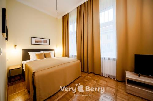A bed or beds in a room at Very Berry - Podgorna 1c - Old City Apartments, check in 24h