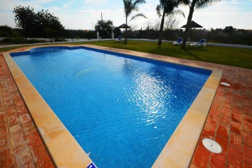 The swimming pool at or near Villa Casa das Amendoeiras