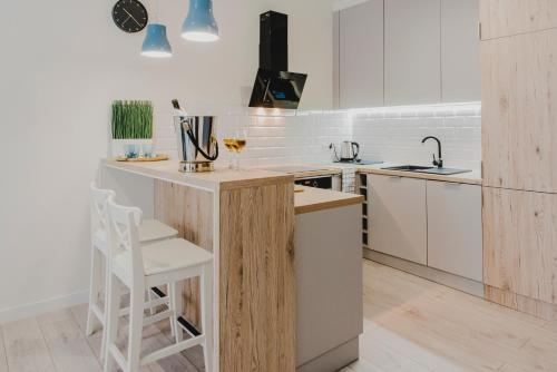 Una cocina o kitchenette en Feriatum Rent Centrum