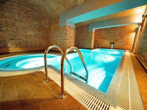 The swimming pool at or near Luxuryapartments - Radziwiłłowska Old Town