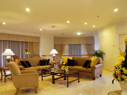 منطقة جلوس في Aryaduta Suite Semanggi