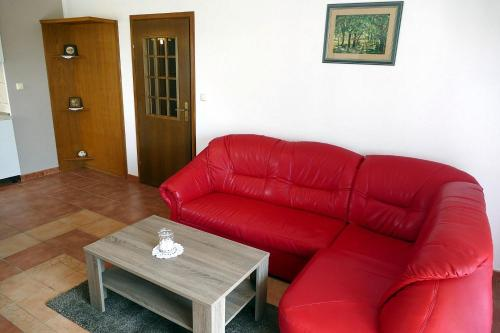 A seating area at Apartman Jakov