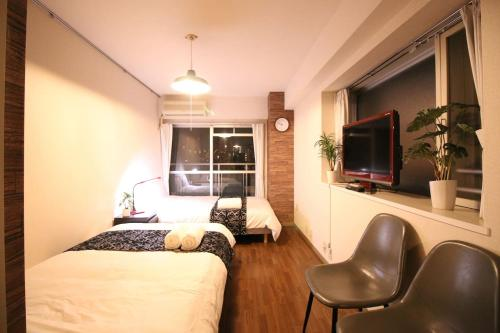A television and/or entertainment centre at MG507 Cozy and clean room SHINAGAWA