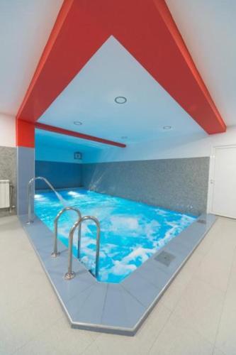 The swimming pool at or near Hotel Piramida