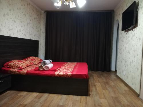 Кровать или кровати в номере Apartment on Nurken Abdirova,34/3