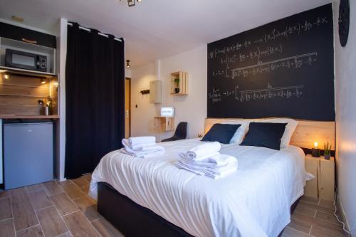 Un ou plusieurs lits dans un hébergement de l'établissement LE RACINE CARREE