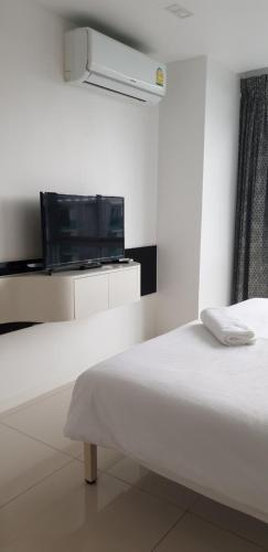 Телевизор и/или развлекательный центр в City Center Residence Pattaya