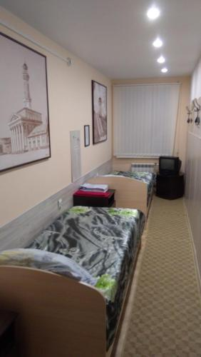 A bed or beds in a room at Economy-Class Hotel V Tsentre Goroda