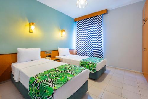 Кровать или кровати в номере King's Suit Apart Otel