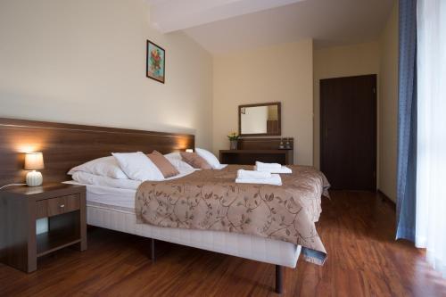Łóżko lub łóżka w pokoju w obiekcie Bellamonte Aparthotel