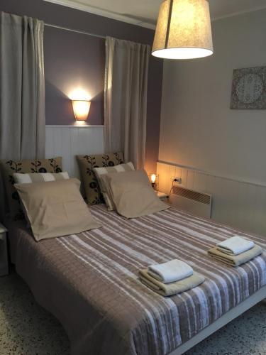 Un ou plusieurs lits dans un hébergement de l'établissement Auberge des crêtes