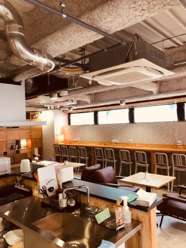 A restaurant or other place to eat at Iyasu Hostel Sapporo