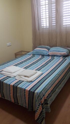 Cama o camas de una habitación en Apartamentos Huelin Playa