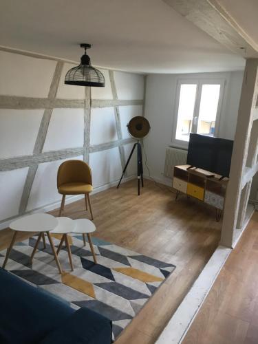 A seating area at Les Appartements de Home Petite Venise
