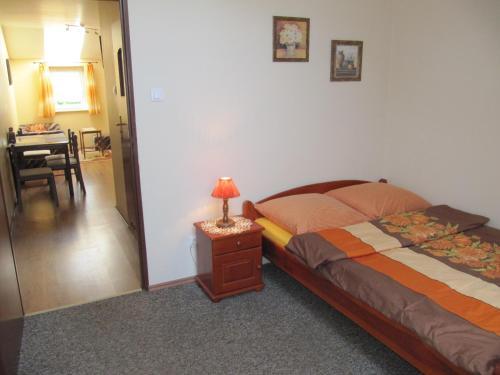 Łóżko lub łóżka w pokoju w obiekcie Apartamenty Na Wyspie