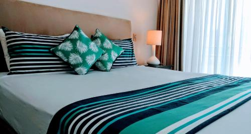 A bed or beds in a room at OCEAN VIEW BEAUTY IN CROWN TOWERS