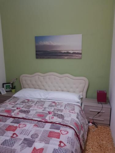 A bed or beds in a room at THE BEST GUEST HOUSE