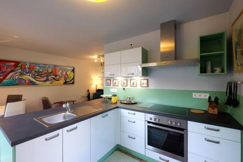 A kitchen or kitchenette at Bie de Borreger