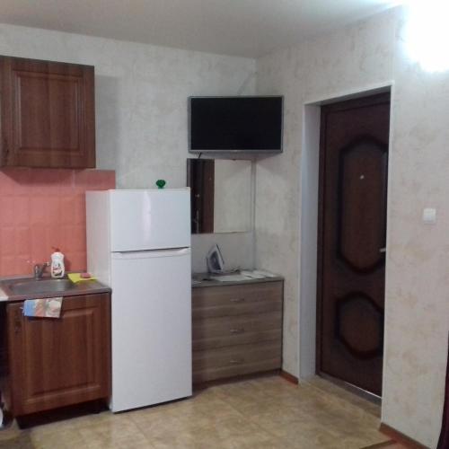 A kitchen or kitchenette at Guest House on Pyatigorskaya Street