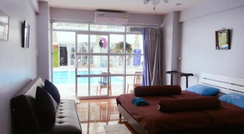 Гостиная зона в 尼兰国际公寓 Nirun condo