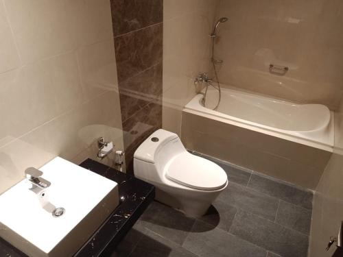 A bathroom at The Surya Kuta Villa