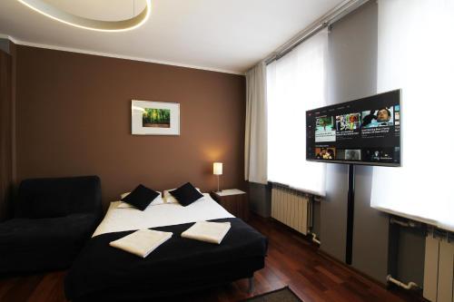 Lova arba lovos apgyvendinimo įstaigoje Rainbow Apartments 1