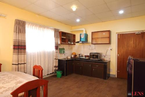 A kitchen or kitchenette at Hotel Melungtse