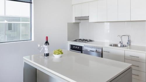 A kitchen or kitchenette at Apartments @ 212 Margaret