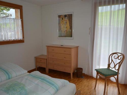 Ein Bett oder Betten in einem Zimmer der Unterkunft Apartment Spillgerten-Blick