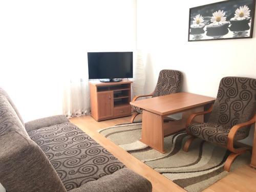 Een TV en/of entertainmentcenter bij Grochowska Apartament